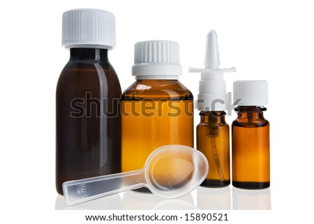 medical flask, nasal spray and a measuring spoon isolated on white background - stock photo