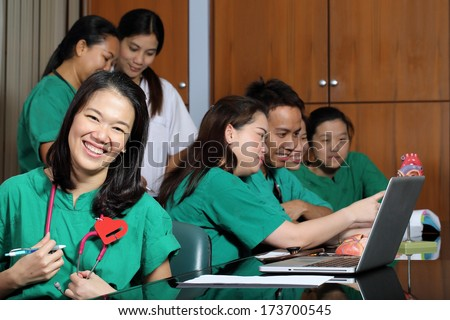 Medical Group studying Cardiologist in Classroom - stock photo