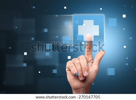 Medical. Hand press on First Aid sign - stock photo