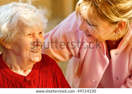 medical helping an old woman - stock photo