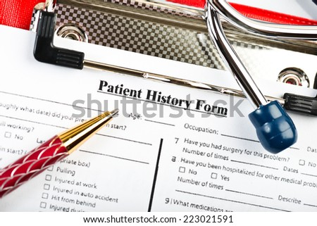 medical history with stethoscope and pen  - stock photo