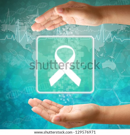 Medical icon Aids ribbon in hand - stock photo