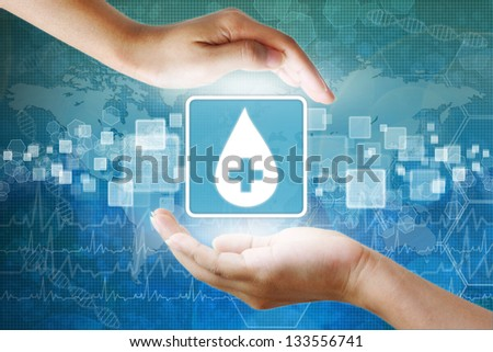 medical icon, Donate blood Blood Drop symbol in hand - stock photo