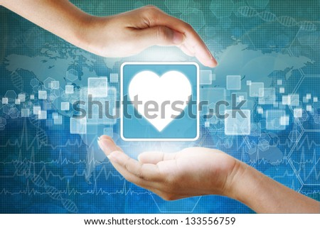 medical icon, Heart symbol in hand - stock photo