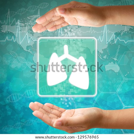 Medical icon Lung in hand - stock photo