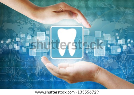 medical icon, Tooth symbol in hand - stock photo