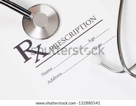 Medical ideas - blank prescription and stethoscope - stock photo