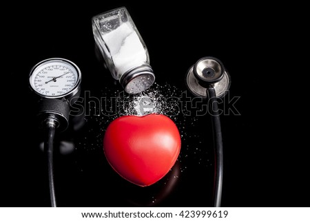 Medical instrument isolated on black background with reflection - stock photo