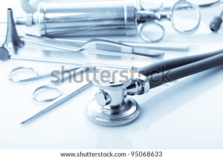 Medical instruments for ENT doctor on white - stock photo