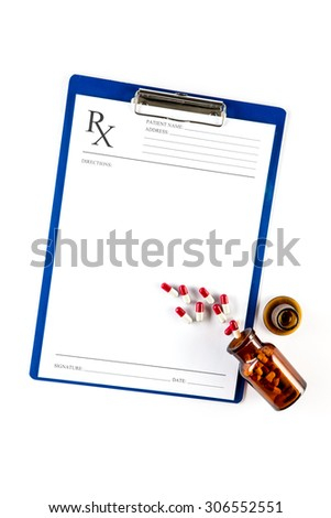 Medical insurance and healthcare, RX form with Capsules and clipboard - stock photo