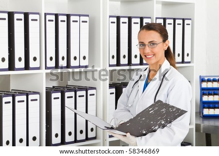 medical intern searching for patient's records in office