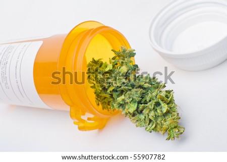 Medical marijuana - a manicured Cannabis bud in a prescription bottle, symbolizing medical marijuana. - stock photo