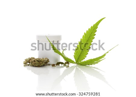 Medical marijuana. Cannabis bud and hemp leaf and white container isolated on white background with reflection - stock photo