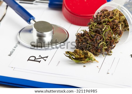 Medical marijuana in jar lying on prescription form near stethoscope. Cannabis recipe for personal use. Legal drugs concept - stock photo