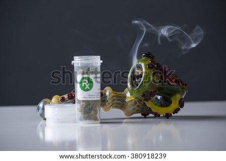 Medical marijuana prescription pipe smoking - stock photo