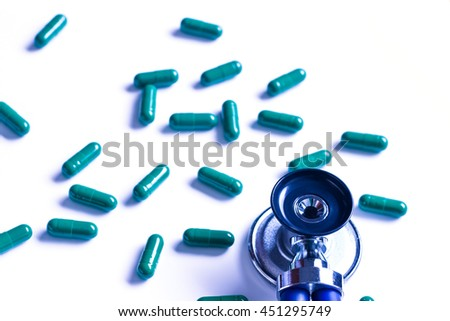 Medical, medicine stethoscope and pills on blue background. Health care or illness. Tablet or drug in hospital or pharmacy. Cardiology heart treatment. Medication prescription  - stock photo