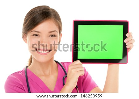 Medical nurse doctor showing tablet pc computer green screen with copy space for your text or design. Mixed race Asian Chinese / Caucasian female medical professional smiling happy on white background - stock photo