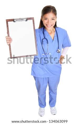 Medical nurse woman or doctor showing clipboard sign standing in full body length smiling happy in blue scrubs isolated on white background in studio. Multicultural female Asian medical professional. - stock photo