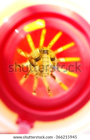 Medical or clinical sharps yellow waste container - stock photo