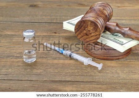 Medical or Narcotic Drugs, Syringe  And Wad Of Money On Grunge Wood Table - stock photo