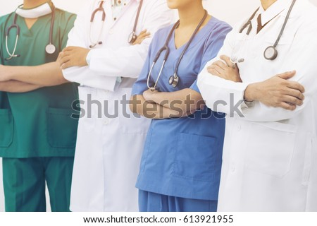 Medical people - doctors, nurse and surgeon.