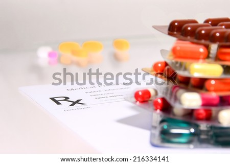 Medical Pharmacist prescription stuff  form - blank prescription and pills on table  - stock photo