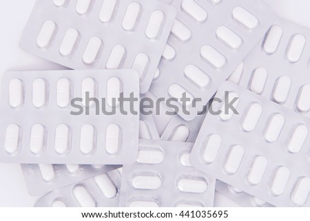 medical pills in Silver blister packs isolate on white background. - stock photo