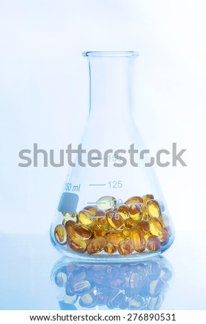 medical pills in the Erlenmeyer flask - stock photo