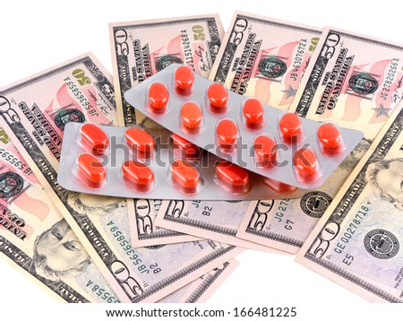 medical pills on dollars bank note as symbol for high costs - stock photo