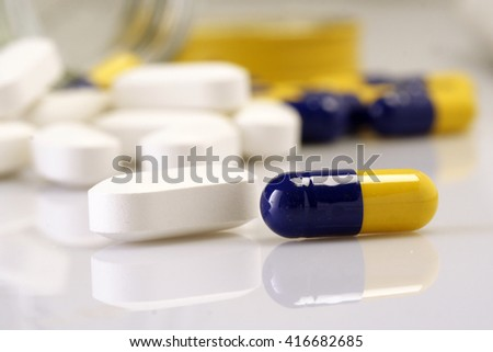 Medical pills spilled out of bottle - stock photo