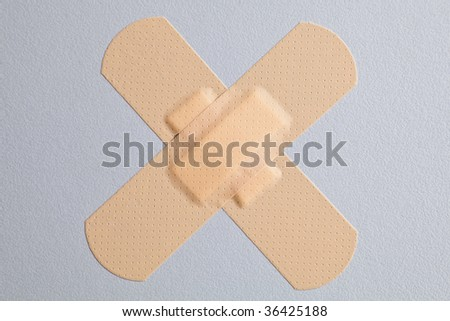 Medical plaster pasted by a cross