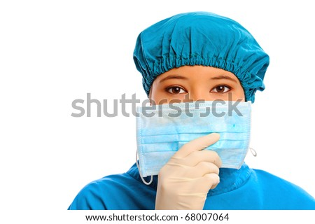 Medical professional puts on a mask, isolated on white