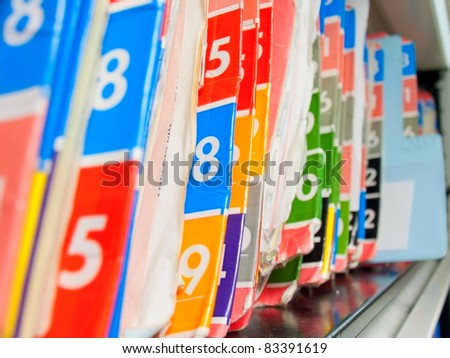 Medical Records folder archive organized in the file cabinet. - stock photo