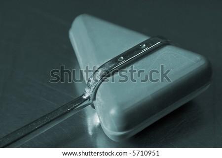 medical reflex hammer - stock photo