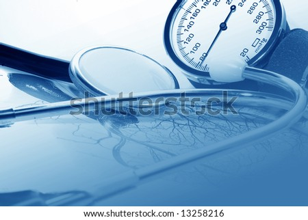 medical report and sphygmomanometer - stock photo