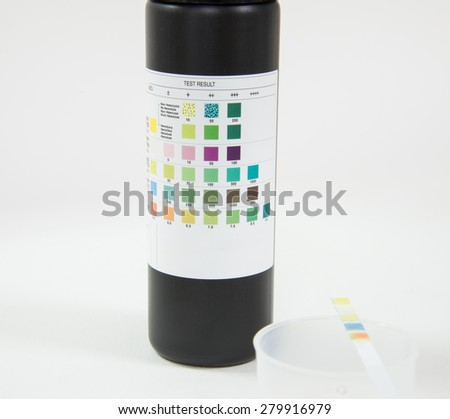 Medical report and urine test strips - stock photo