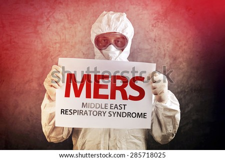 Medical Scientist Holding Banner with MERS Virus Definition - stock photo