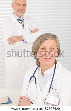 Medical senior doctor female work computer with professional male colleague