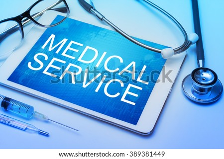 Medical Service word on tablet screen with medical equipment on background - stock photo