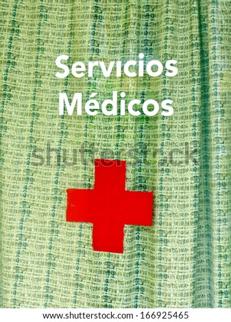 Medical services sign in Spanish - stock photo