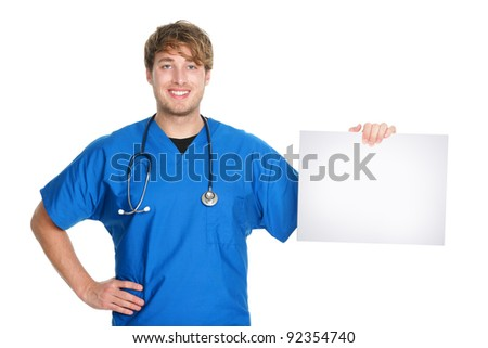 Medical sign. Male doctor / nurse showing and holding blank white paper sign board with copy space for text or message. Young medical professional caucasian man isolated on white background. - stock photo