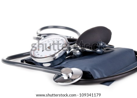 Medical sphygmomanometer on a white background - stock photo