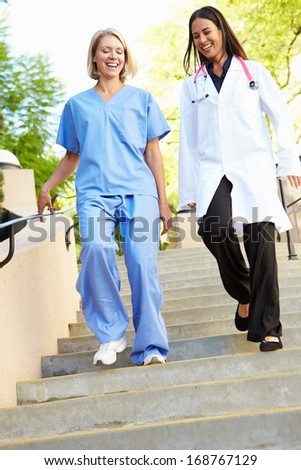 Medical Staff Having Discussion Outdoors - stock photo