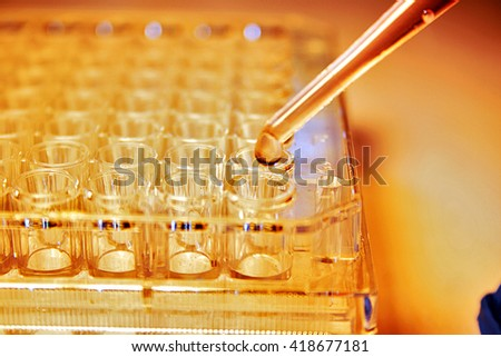 Medical Stem Cell Research Flask with Pipette - stock photo