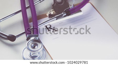 Medical stethoscope and a plate on the table