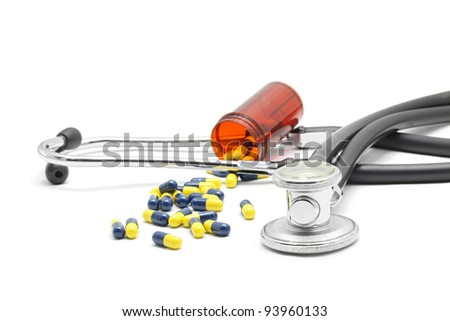 Medical Stethoscope and Capsule on white background for Healthy Concept - stock photo