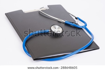 Medical stethoscope and clipboard on a white background. - stock photo