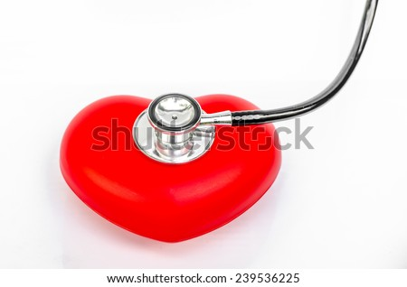 Medical stethoscope and heart on white background - stock photo