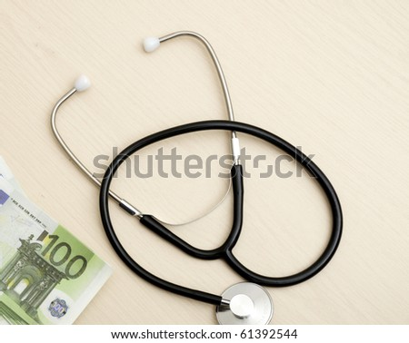 Medical stethoscope and monetary denominations of euro, close up