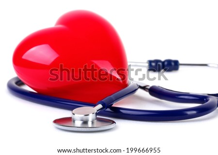 Medical stethoscope and red heart - stock photo